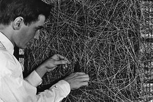 Photo of a man rewiring a Mark 1 computer, 1950s